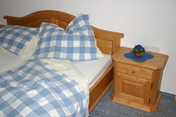 Bett in der Ferienwohnung